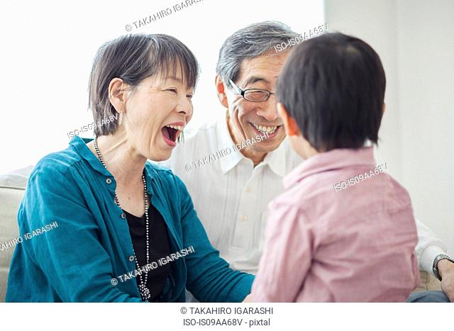 Grandparents with grandson laughing