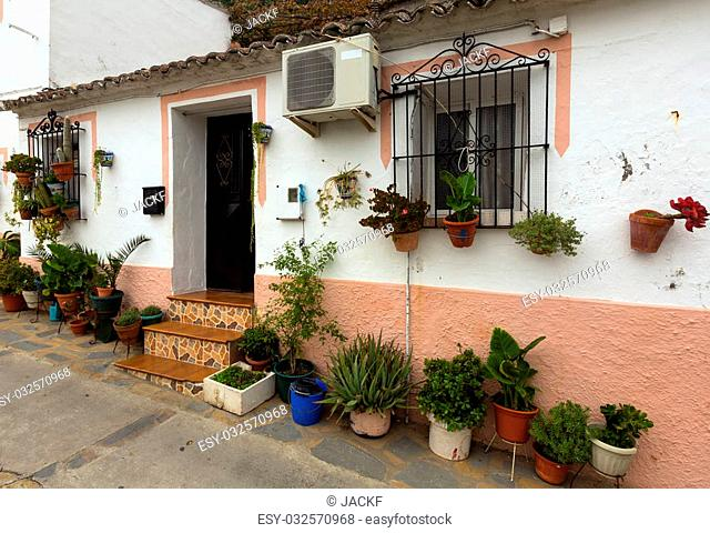 Dwelling house with flowers in pots. Ubrique, Spain