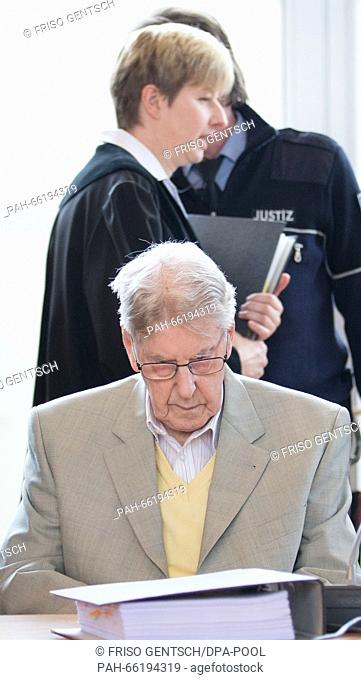 Judge Anke Grudda (back) walks past former Auschwitz SS-guard Reinhold Hanning, who sits in the courtroom during his trial in Detmold, Germany, 26 February 2016