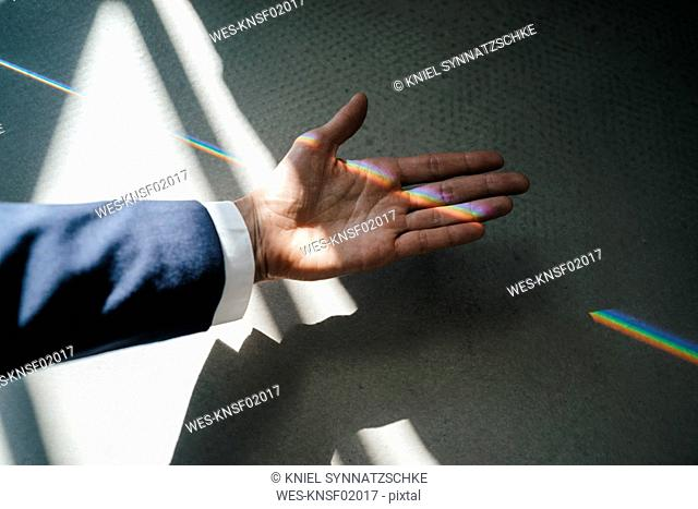 Woman with light refraction on her hand