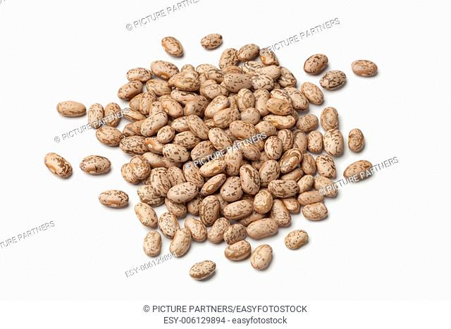 Heap of pinto beans on white background