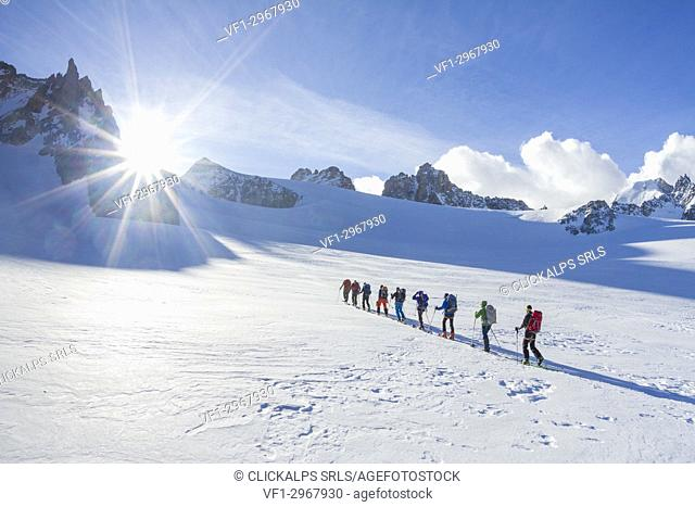 Skiers at Aiguille du Tour during winter. Argentera, France, Europe