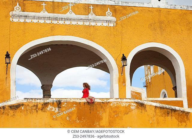 Tourist woman at the Monastery-Convent Of San Antonio De Padua, Izamal, Yucatan, Yucatan Province, Mexico, North America