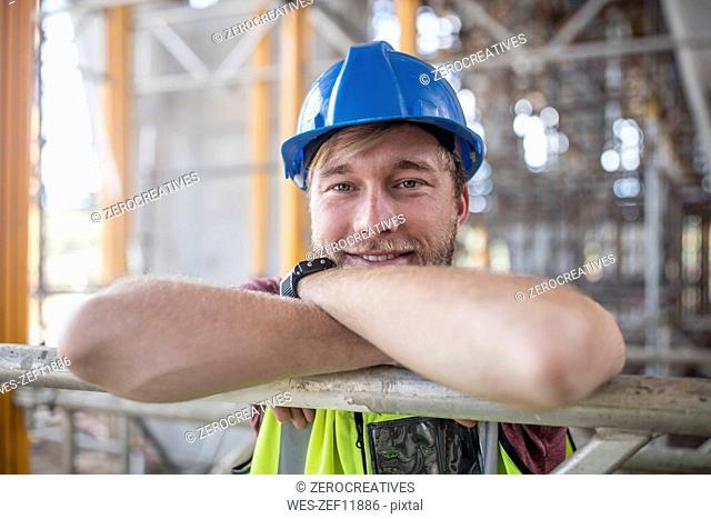 Construction worker on construction site, portrait