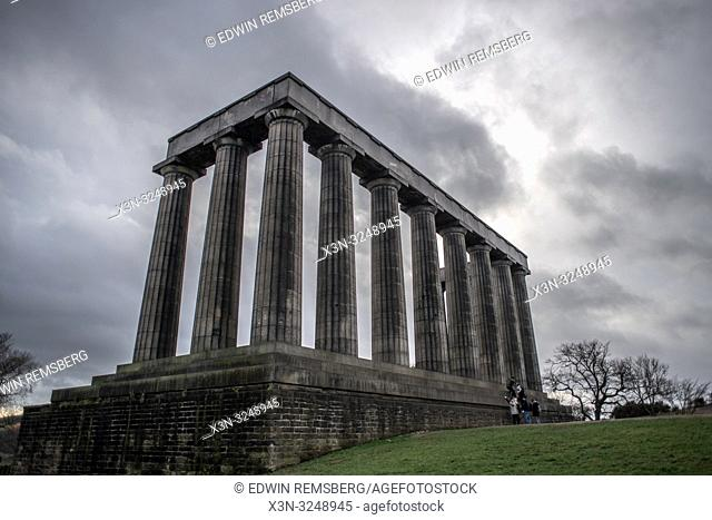 National Monument of Scotland stands tall against cloudy skies, Edinburgh Scotland