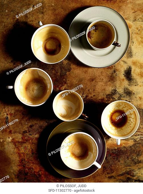 Used coffee cups and saucers