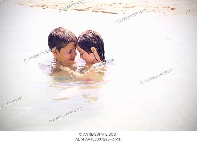 Children playing together in the sea