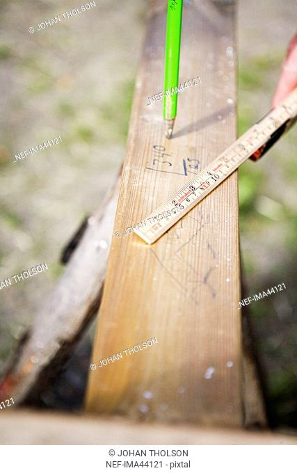 Folding rule plank and a pencil Sweden