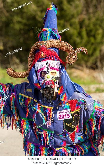 Traditional Cajun Mardi Gras costumed reveler during the Courir de Mardi Gras chicken run on Fat Tuesday February 17, 2015 in Eunice, Louisiana
