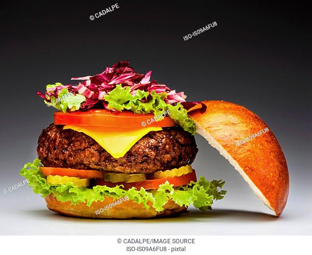 Burger with slice of apple