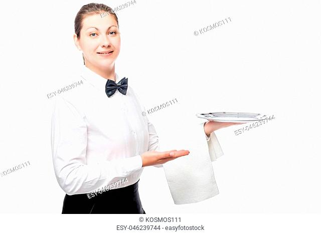 Happy waitress with an empty silver tray, portrait isolated on white background