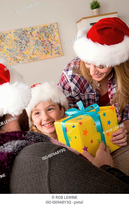 Parents giving child christmas gift