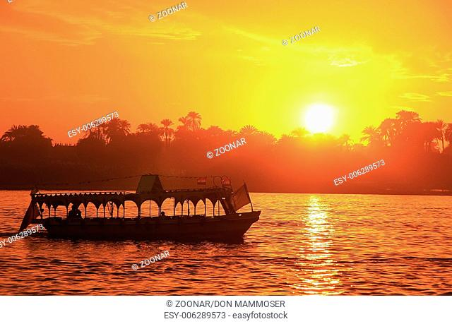 Boat cruising the Nile river at sunset, Luxor, Egy