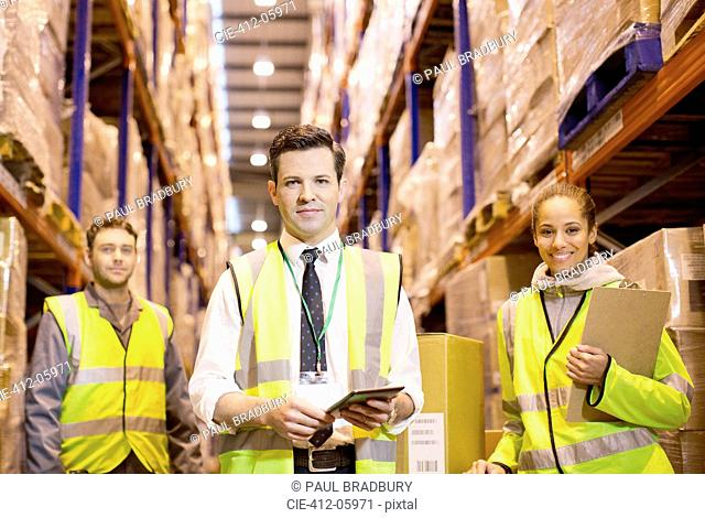 Workers standing in warehouse