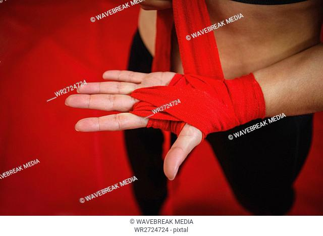 Female boxer wearing red strap on wrist