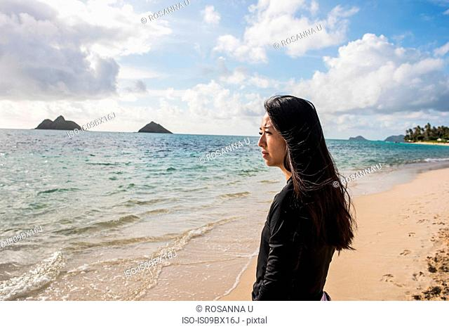 Woman looking out to sea, Lanikai Beach, Oahu, Hawaii