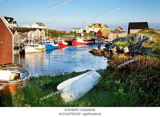 Fishing boats tied up alongside the wharf at Peggy's Cove, Nova Scotia