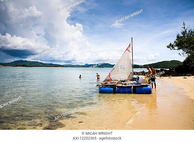 A group of backpackers decide to build their own raft and attempt to raft from Langkawi, Malaysia to Ko Lipe, Thailand; Cenang, Langkawi, Malaysia