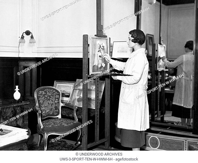 California: October, 1935.Tennis champion Helen Wills Moody painting on an easel in her home