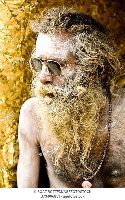 A cool Naga sadhu wearing sunglasses