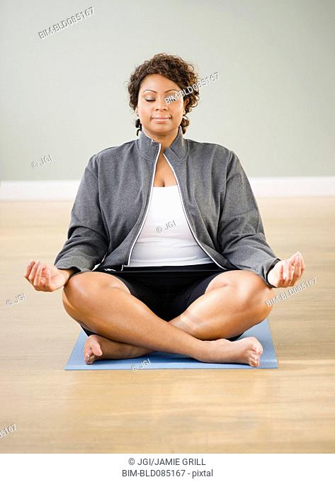 African American woman practicing yoga