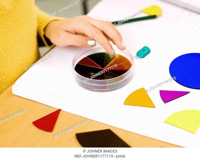 Girl doing artwork on paper