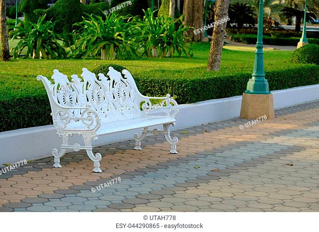 White lounge chair during a walk in the park