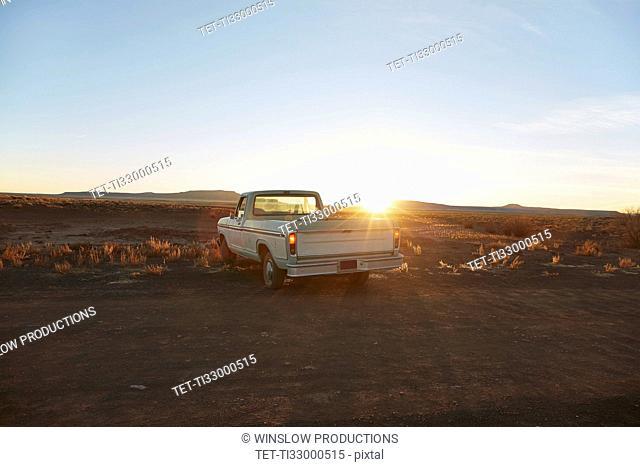 USA, Arizona, Pick-up truck on desert road