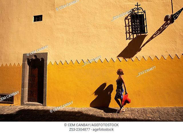Woman walking around the Columbus House-Casa de Colon in Vegueta neighborhood, Las Palmas de Gran Canaria, Canary Islands, Spain, Europe