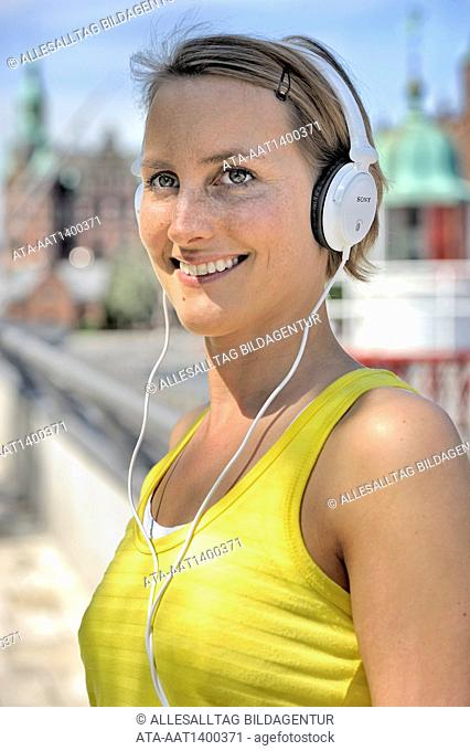 Woman with headphones is going for a run