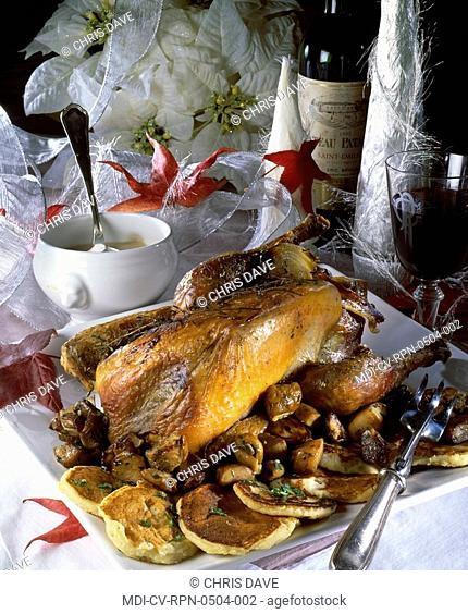 Guinea hen with cepes