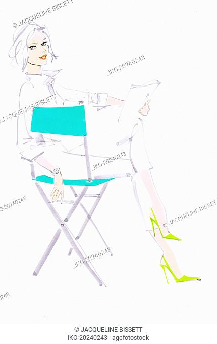 Elegant woman reading script in director's chair