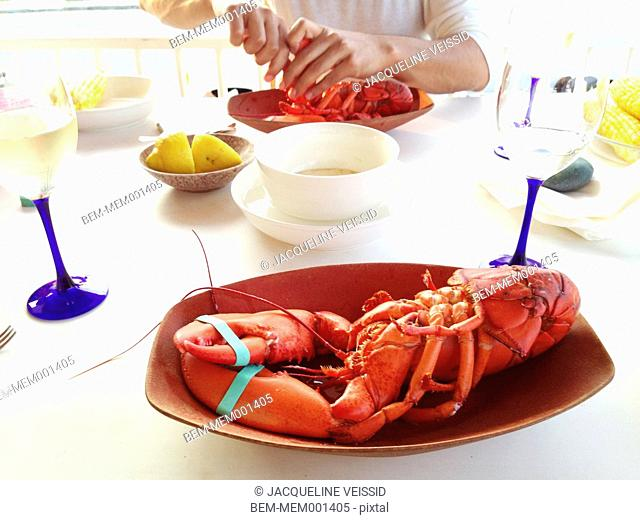 Plate of fresh lobster with butter and lemon