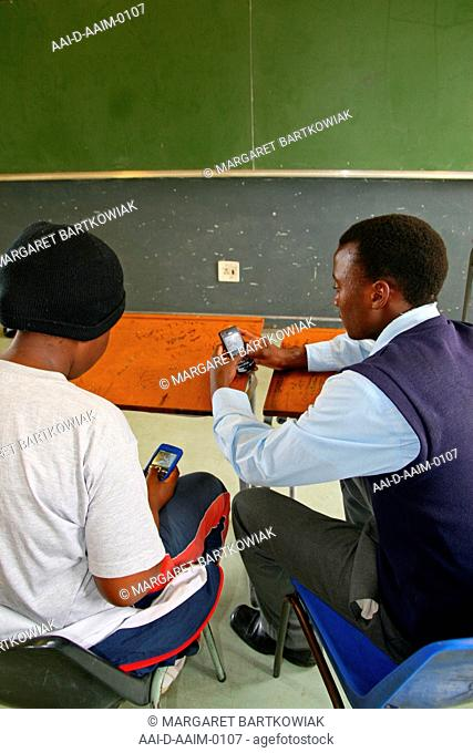School children on their cellphones in class, St Mark's School, Mbabane, Hhohho, Kingdom of Swaziland