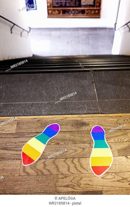 Rainbow flag footprints on steps