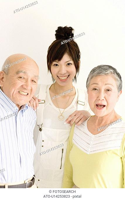 Family Portrait with Grandparents and Granddaughter, Front View, Looking at Camera