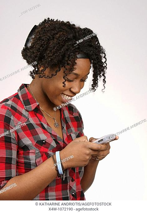 Young African-American woman texting