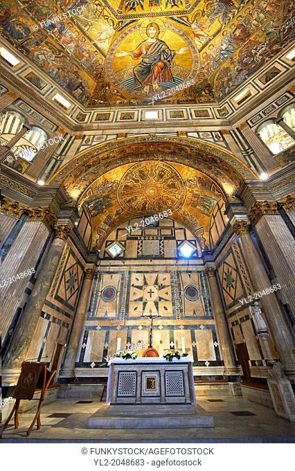 The interior of the Bapistry of Florence Duomo ( Battistero di San Giovanni ) with the altar and medieval ceiling mosaics of Christ and the last judgement