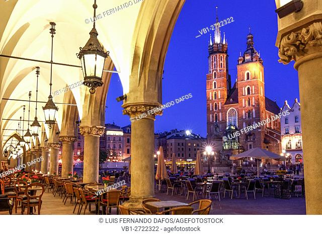 Krakow Market Square at dusk basilica of the assumption of our lady (st mary's) seen from market arcade. Poland