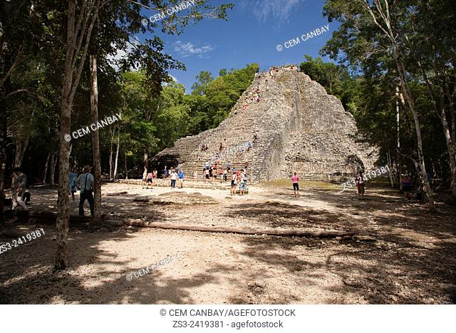 Tourists climbing up to the Nohoch Mul Pyramid at the Prehispanic Mayan city of Coba Archaeological Site, Quintana Roo, Yucatan Province, Mexico