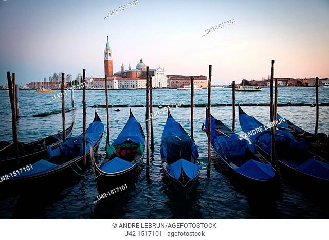 Gondolas moored by Piazzetta di San Marco and looking towards Isola di San Maggiore in Venice, Veneto, Italy