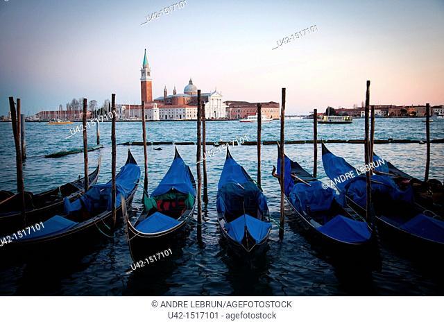 Gondolas moored by Piazzetta di San Marco and looking towards Isola di San Maggiore in Venice, Veneto, Italy