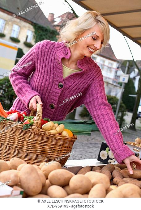 Blond woman shopping on weekly market