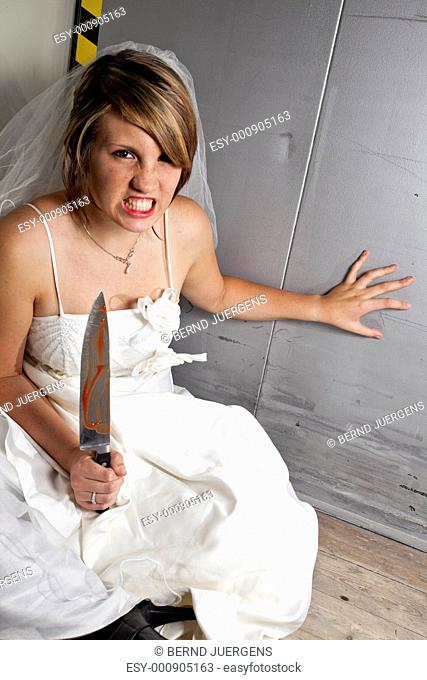 Angry young Bride with a bloody Knife in a Lift
