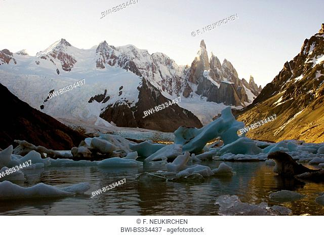 Cerro Torre, icebergs at the Laguna Torre, backlight (evening), Chile, Patagonia, Los Glaciares National Park, El Chalten
