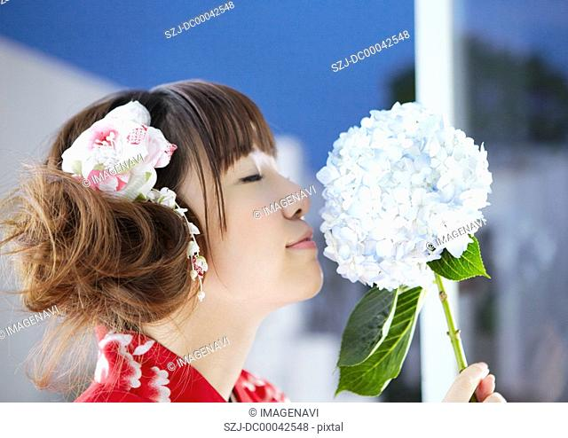 Young woman holding hydrangea