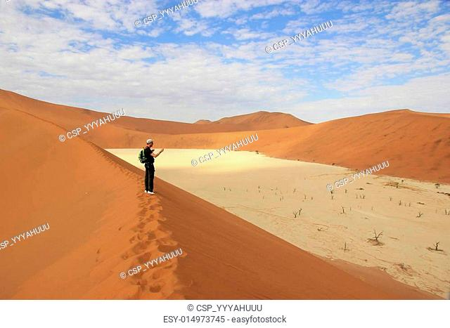 Tourist in the Sossusvlei desert, Namibia