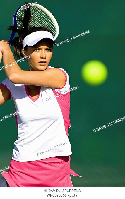 Tennis player focused on ball