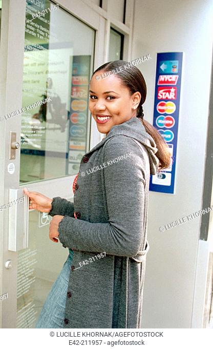 Girl entering a bank