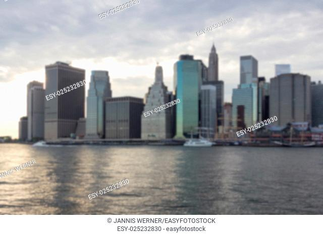 Blurred background of Financial District skyline in downtown Manhattan set against evening clouds
